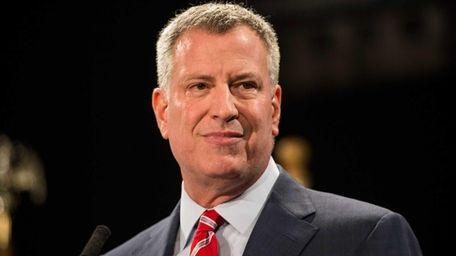 New York City Mayor Bill de Blasio delivers