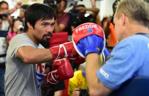 Manny Pacquiao spars with his trainer Freddy Roach