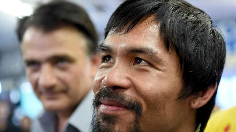 Manny Pacquiao speaks to media before a workout