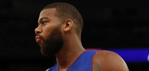 Greg Monroe of the Detroit Pistons looks on