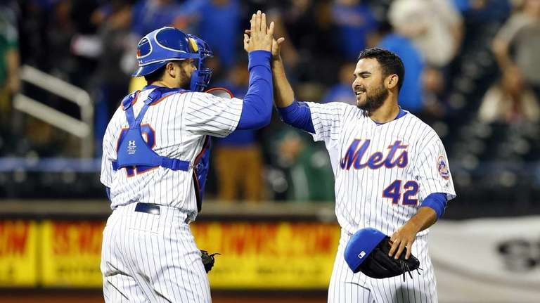 Alex Torres, right, and Travis d'Arnaud of the