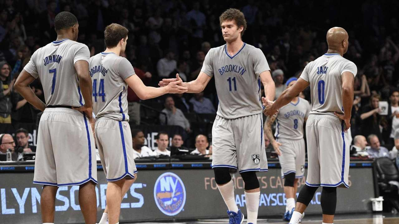 Brooklyn Nets center Brook Lopez low fives guard