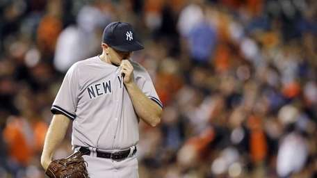 New York Yankees relief pitcher Justin Wilson pauses