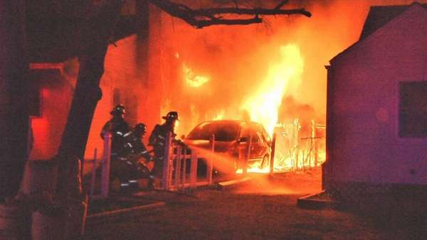 Firefighters battle a blaze affecting two Patchogue homes,