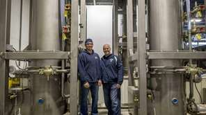 Arctic site plant manager Brent Hill, left, stands