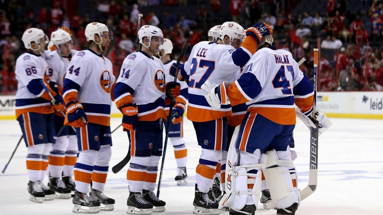 The Islanders celebrate after their 4-1 win over