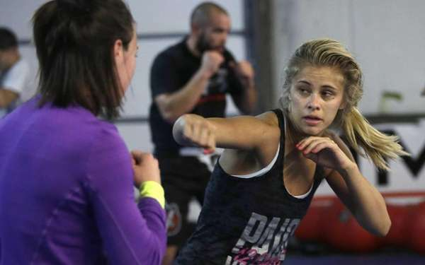 Aixed martial arts fighter Paige VanZant, right, spars