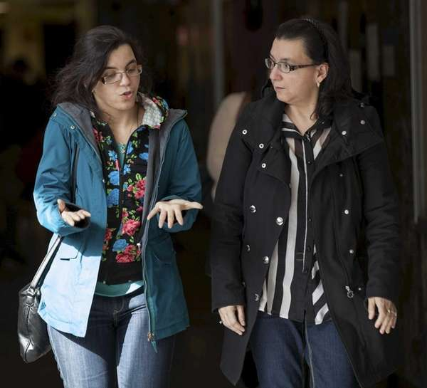 Becky Hernandez, left, daughter of Pedro Hernandez and