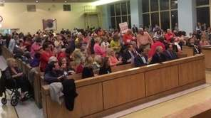 Residents react in support of a speaker advocating