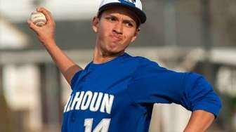 Calhoun starting pitcher Dylan Hughes throws in a