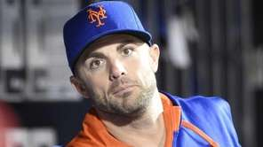 Mets third baseman David Wright looks on from