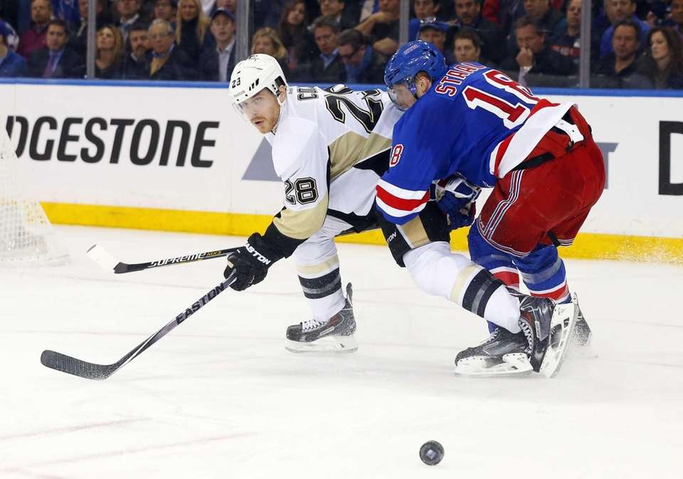 Marc Staal of the New York Rangers defends