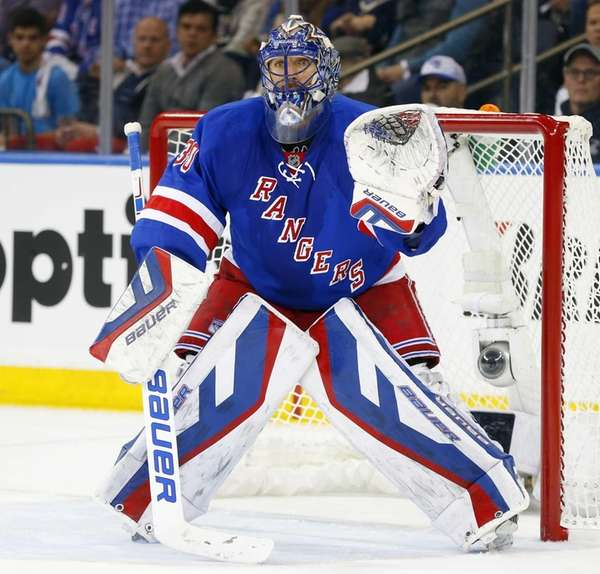 Henrik Lundqvist of the New York Rangers defends