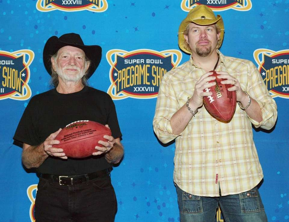 Toby Keith, right, hangs out with Willie Nelson