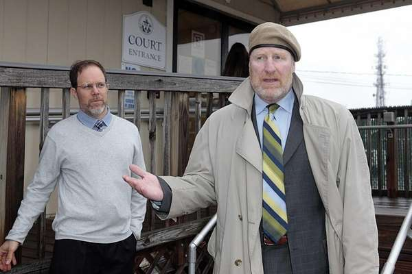 Fisherman Bill Reed, left, and his attorney Daniel