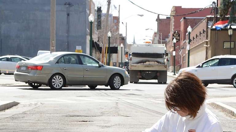 Elaine Santore fills a pothole in the middle