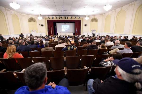 People attend a meeting of the Town of