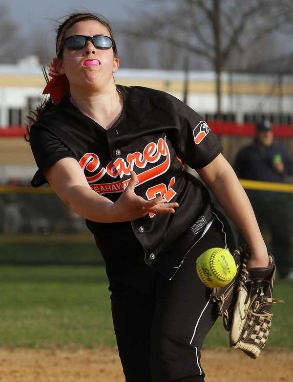 Carey's Jenna Turato throws to the plate during