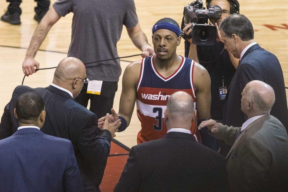 The Washington Wizards' Paul Pierce, center, is congratulated