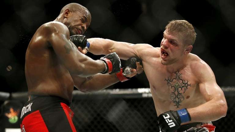 Chris Dempsey, right, punches Eddie Gordon during a