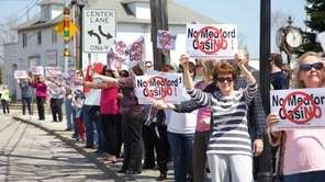 Local residents and civic group members stand with