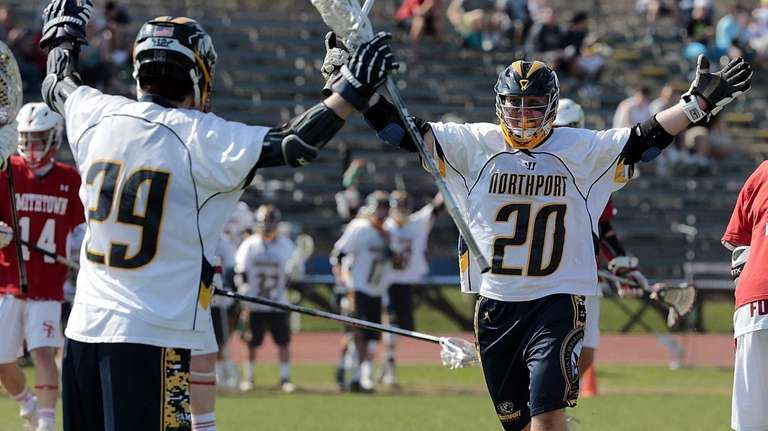 Northport's Jack Sullivan (20) celebrates a score off