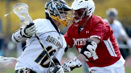 Northport's Ryan Magnuson (16) foes head-to-head on a