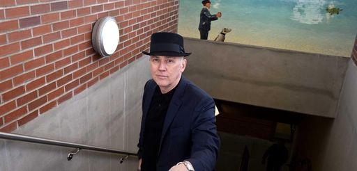 Peter Drake, an artist from Manhattan, stands in