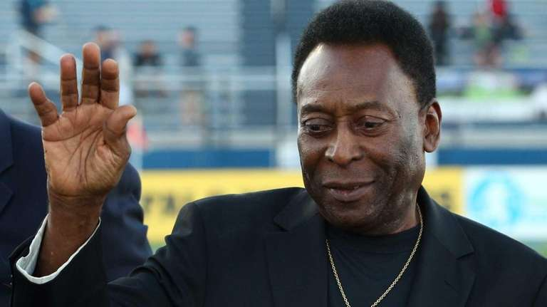 Cosmos legend Pele waves to the crowd before