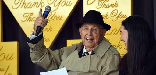 A. Alfred Taubman smiles as he speaks during