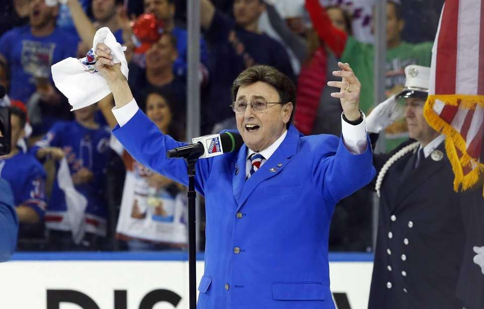John Amirante sings the national anthem before Game
