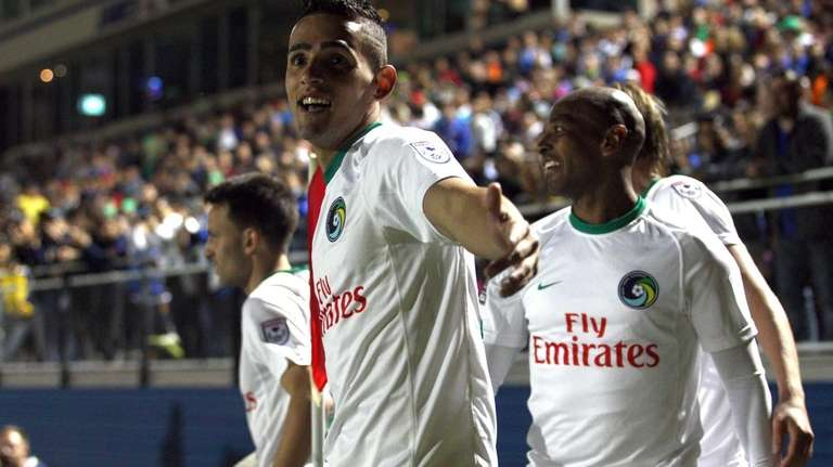 New York Cosmos midfielder Leo Fernandes #22, right,