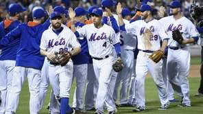 The New York Mets celebrate their 5-4 win