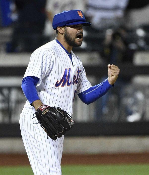 New York Mets relief pitcher Alex Torres reacts