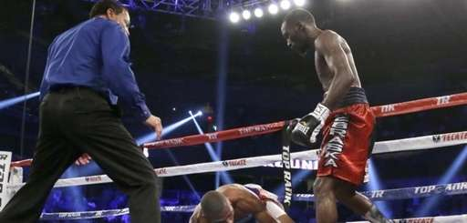 Terence Crawford, right, stands over Thomas Dulorme after