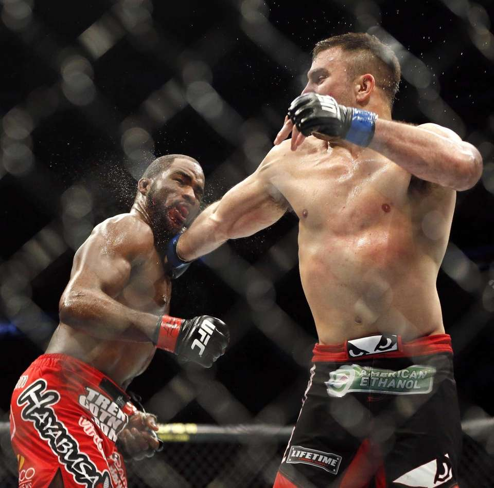 Corey Anderson, left, takes a punch from Gian