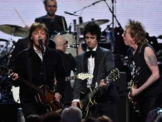 Inductees Ringo Starr and Billie Joe Armstrong of