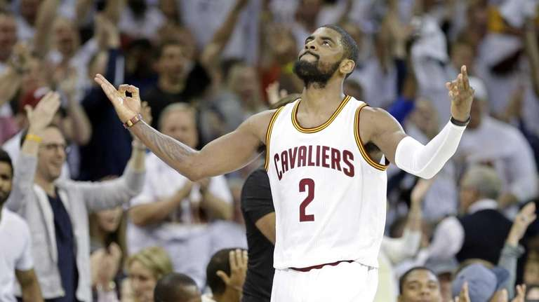 The Cleveland Cavaliers' Kyrie Irving celebrates after making