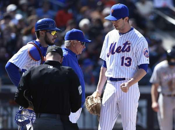 New York Mets manager Terry Collins checks on