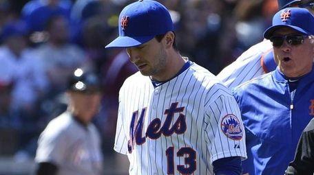 New York Mets relief pitcher Jerry Blevins walks