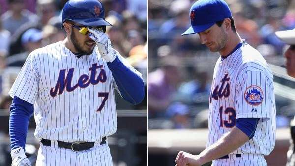 Mets catcher Travis d'Arnaud, left, and reliever Jerry