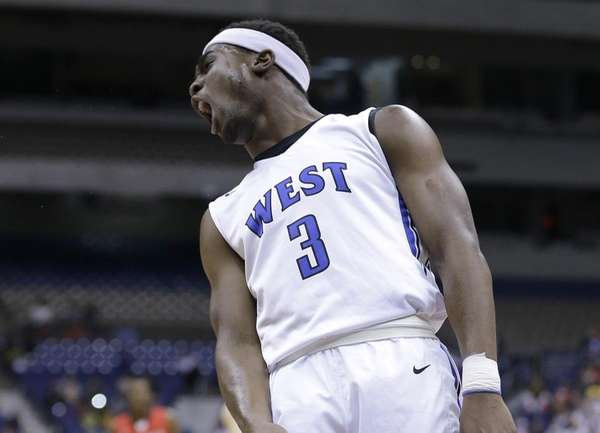 Plano West's Soso Jamabo (3) celebrates after a