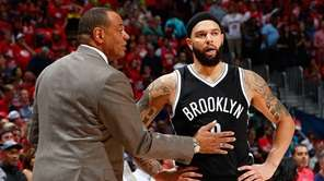 Lionel Hollins of the Brooklyn Nets converses with