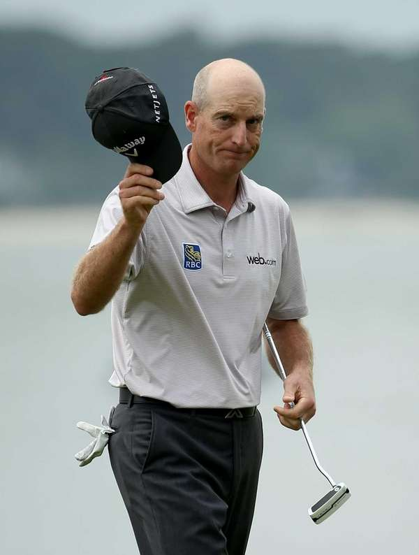 Jim Furyk reacts after a putt on the