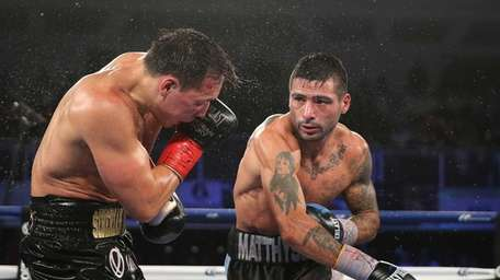Lucas Matthysse, right, throws a right cross to
