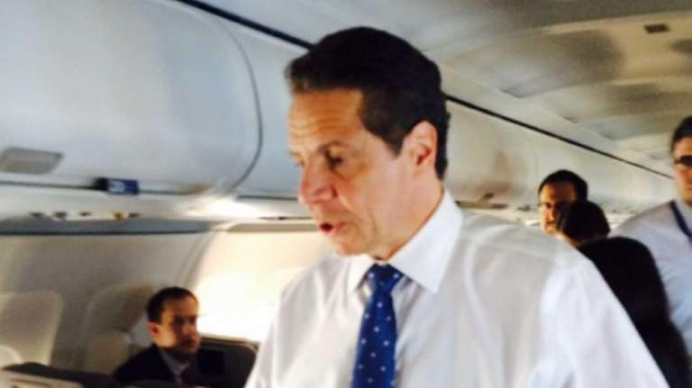 Gov. Andrew Cuomo on the plane as he