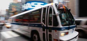 An MTA bus drives through New York City.