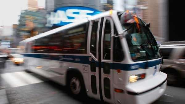 An MTA bus drives through New York City.