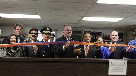 Acting Nassau Police Commissioner Thomas Krumpter, center, along