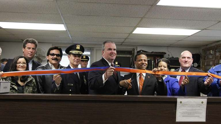 Acting Nassau Police Commissioner Thomas Krumpter, center, along